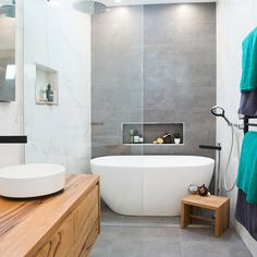 remove the bath. the tile colours and where they are. Timber element and black tapware