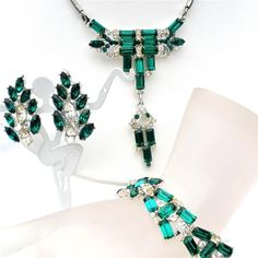 Art Deco Rhinestone Demi Parure - This is a high end three piece rhodium plated set of lavalier necklace, earrings and bracelet. It has emerald green and clear rhinestones in several sizes and shapes.