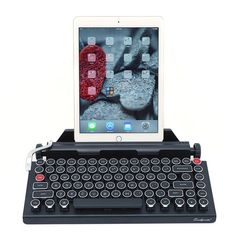 QWERTYWRITER is a vintage typewriter inspired wireless mechanical keyboard. It features all aluminum body construction and click mechanical switches. It has a built in tablet stand that fits up to 5/8 inch thick and large as the 12 inch iPad pro.