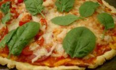 Gluten-free tomato and salami pizza
