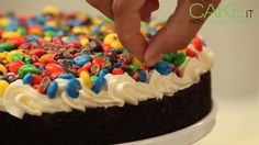 Root beer chocolate cake with vanilla buttercream and crushed M&M's - just one layer of my Movie Night Cake! #Dessert #Baking #Cakes