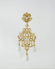 24 Karat gold plated scroll design drop earring with white faceted tear drops and white glass stones. Earring is inches long and inches at widest point. This earring is a clip on. Chandler Earrings, Scroll Design, Fashion Boutique, Stud Earrings, Tear Drops, Gold, Stones, Explore, Glass