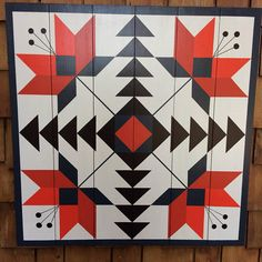 "32""X32"" SCARLET LILY BARN QUILT: hand painted on Western Red Cedar Pallet.  All my Barn Quilts are painted on new, #1 quality Western Red Cedar ¾"" x 5 ¼"" fence boards. Unlike plywood or MDO, cedar is insect and decay resistant, making them ideal for outdoor or indoor locations. Additionally, the cedar ages, your outdoor Barn Quilt will develop a beautiful patina. The painted surfaces are sanded smooth,highlighting the figured wood grain. The cedar is sealed, painted with premium acrylic…"