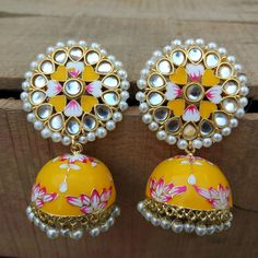 A pair of golden-toned Traditional Floral Hand Painted Yellow Meenakari Jhumka for Women. This Lightweight dome Shaped Meenakari Earrings with Hanging Pearls is Earrings For Saree, Indian Jewelry Earrings, Indian Jewelry Sets, Jewelry Design Earrings, Indian Wedding Jewelry, Gold Earrings Designs, Ear Jewelry, Antique Earrings, Jhumki Earrings