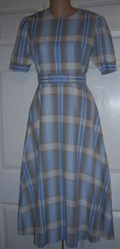 Very pretty, modest dress.  Love the pattern and color.