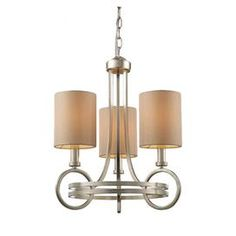 Silver leaf-finished chandelier with fabric shades.   Product: Chandelier   Construction Material: Steel Color: Silver leaf and creamFeatures: Art Deco-inspired design       Accommodates: (3) 60 Watt candelabra bulbs - not included   Dimensions: 18 H x 16 Diameter