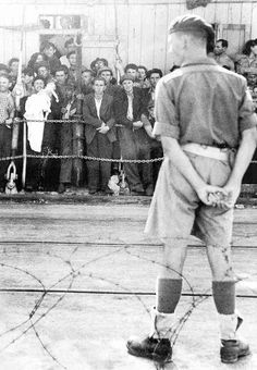 A British soldier at the Haifa docks guarding Jews barred from entering Eretz Israel
