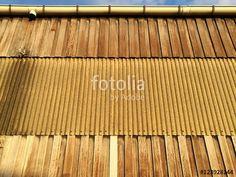 Fassade einer alten Lagerhalle mit Holz und Wellblech im Licht der Abendsonne in Münster in Westfalen im Münsterland
