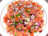 Fresh Pico de Gallo is a great topping for nachos, fish or chicken. It has only 10 calories per serving and is loaded with antioxidants and delicious flavor.