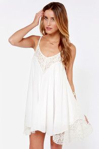 As soft as a mountain breeze and sweet as ice cream, the Easy Honey Ivory Slip Dress is a total treat in everyday proportions! Lightweight woven rayon falls into a triangle bodice with scoop neckline, spaghetti straps, and elegant pierced designs. Relaxed skirt reveals a bit of the lining for a cute tiered effect. Hidden back zipper.