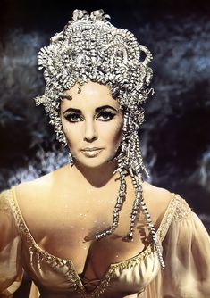 Elizabeth Taylor presents a majestic front as the Egyptian queen in 20th Century Fox's 1963 film ' Cleopatra'. Description from pinterest.com. I searched for this on bing.com/images