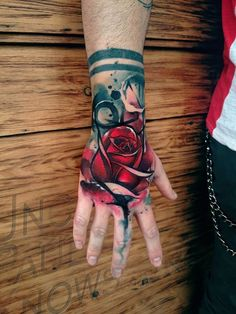 Stunning hand rose tattoo. Photo from www.facebook.com/unclpaulknows.