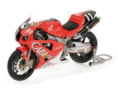 Minichamps 1:12 Honda VTR Diecast Model Motorcycle - 122011446 This Honda VTR 1000 (Valentino Rossi, Colin Edwards - 8Hr Suzuka 2001) Diecast Model Motorcycle is Red and features working stand, steering, wheels and also opening side panels. It is made by Minichamps and is 1:12 scale (approx. 18cm / 7.1in long).