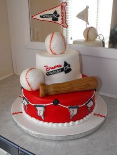 Braves baseball - French vanilla 10'' and 6'' with buttercream covered in MMF. balls are RKT covered in MMF, flag is gumpaste.
