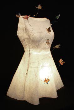 plain dress .paper art work.Butterflies coming out of a woman .Hope through a body. gkaranika .com