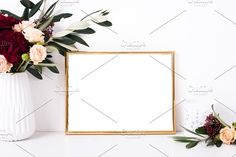 Golden frame mock-up on white wall by Fancy Things on @creativemarket