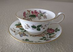 Bone china cup and saucer set by Wedgwood.  Charnwood pattern, made by Wedgwood China Company, England, ca. 1950s.  Excellent condition: no