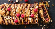 Filled with toasted hazelnuts, juicy raspberries and dark chocolate, this golden danish is best served warm, with a little extra chocolate drizzled on top.