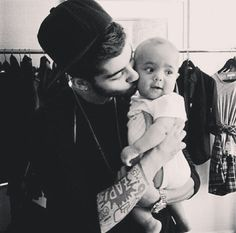 WHO GAVE HIM PERMISSION TO HOLD A BABY?! Please excuse me while i go jump off a cliff