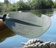 The Backwater Paddle Company Assassin kayak paddle lets you grab docks or gear in the water.