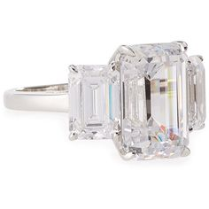 Fantasia by DeSerio Three-Stone Emerald-Cut Cubic Zirconia Crystal... (9.490 NOK) ❤ liked on Polyvore featuring jewelry, rings, accessories, anel, clear, three stone emerald cut ring, 3 stone cubic zirconia ring, 14k cubic zirconia rings, cz rings and 14k ring