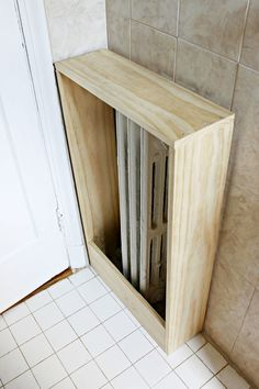 This easy DIY tutorial shows you how to make a radiator cover to cover those unsightly or unused radiators you might have in your home.