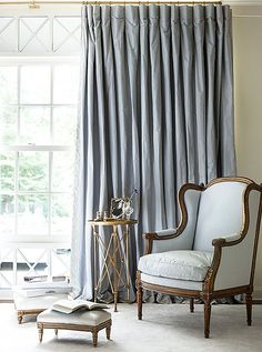 Suzanne Kassler - Silk curtains and an upholstered bergère create a restful corner in shades of pale blue - One Kings Lane