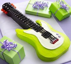 Rock the party with this neon electric guitar-shaped cake—perfect for a rockstar-themed birthday! Click through to download the template; Betty members say it's surprisingly easy.