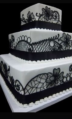 Tiered, square wedding cake with lace details from #Oakmont #Bakery
