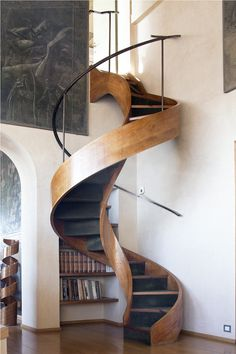 Handsome staircase.  It's clear that the owner of this home is fond of curves. Each element provides interest, yet the vista might be more harmonious if the eye did not have to view them simultaneously.