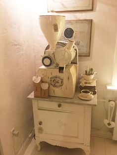 My very old white painted shabby chic coffeegrinder in my romantic livingroom