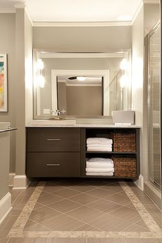 The floor tile is Fabrique from Dal Tile in Gris Linen. The stone tile border is from Ann Sacks and is Bali Palermo. The wall tile in the shower is Daltile Rittenhouse Square in Gray Matte.