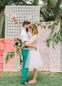 Boho bride and groom wearing aqua colored pants, short sleeve button up shirt, and aqua tie @myweddingdotcom