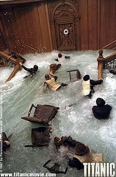 water flooding the grand staircase during the sinking of the Titanic in the 1997 film
