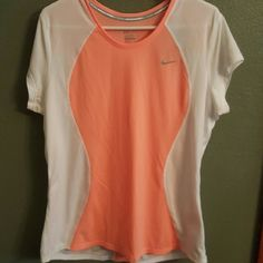 NWT Nike Dryfit  Workout Top You workout harder when you look good (I'm sure it's scientifically proven somewhere!). Don't waste another workout!!  Look good now in this Nike Dri-fit top. Nike Tops Tees - Short Sleeve