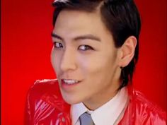T.O.P from Big Bang. absolutely love his smile here