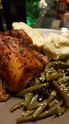 Roasted Cornish hen, fresh green beans with dried cranberries and sesame seeds, side of mashed potatoes