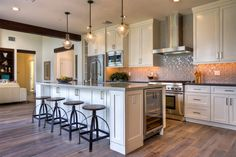 The ultimate kitchen island comes complete with a built-in wine cooler and all the cabinets you could ever need.