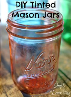 DIY Tinted Mason Jars - this fun and easy tutorial shows you how to tint your own mason jars into whatever fun colors your heart desires. Great for weddings, home decor, organizing, baby showers and more!