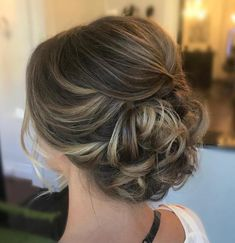 Low Curly Updo with a Small Bouffant
