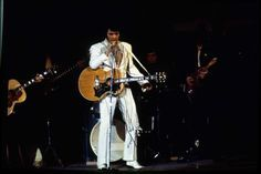 03/01/1970 - singer Elvis Presley performs at the 1970 Houston Livestock Show and Rodeo in the Astrodome. Presley made six appearances over three days at the Houston rodeo. His Saturday evening performance broke all rodeo attendance records with a crowd of 43,614. Fred Bunch / Houston Post Photo: Fred Bunch, HP Staff