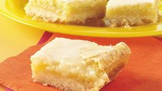 These melt-in-your-mouth lemon bars are bursting with citrus flavor. Even the two-ingredient glaze packs a bright, lemony punch! Made with ingredients that you probably already have on hand, this is the perfect dessert recipe to whip up for big parties or gatherings any time of year.