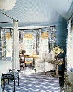 Notice how the wallpaper is horizontal on the wall & vertical on the vaulted ceiling. You have to have an excellent paper hanger to do this right & he's charge a lot, so you'd better really want that effect! I do like the room, but would never put a client though that!