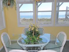 Dining area with an ocean view! The Savvy Seabreeze Oceanfront Condo Vacation Rental in Emerald Isle, NC, 2 Bdr 2Ba. Pier Pointe #Vacation http://www.bluewaternc.com/CrystalCoast/VacationRentals/EmeraldIsle/Details/PierPointeWest3A2/