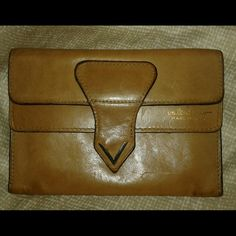 Vintage Valentino snap front leather wallet This listing is for the pictured carmel colored Valentino vintage leather snap front wallet that has  been used. Valentino vintage leather snap front wallet. Thanks for looking! Valentino Bags
