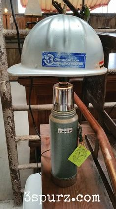 Aluminum hardhat and thermos, these two work site essentials have been combined to create the construction mans lamp. Follow us for more wonderful pins at http://pinterest.com/3spurzdandc/ http://facebook.com/ http://www.3spurzdesignsandcollectables.com/home 3 Spurz D&C Repurposed /Refurbished Creations!!