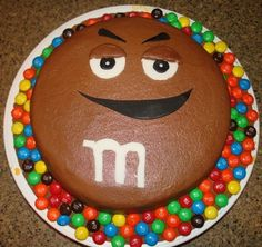 Brown M M cake. We made the yellow M M guy using candy melts poured over cake so it was like a candy shell over chocolate cake! It was for my daughter's coworker who really liked m ms. She loved the cake and the cookies we iced to look like m ms. Mmmmm! B