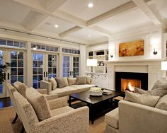 Oh my god! This is my dream living room. No doubt. Perfect blend of contemporary and traditional craftsman style. The ceilings, the doors/windows, the built-ins around the fire place, wow.