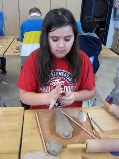 Rolling a sphere head for the clay mummy time capsule.