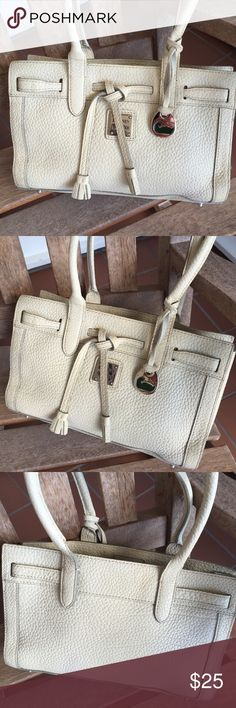 """Dooley & Bourke Beige Swagger Purse Vintage Dooney & Bourke purse in very good pre owned condition. Beautiful beige pebble leather with double handles and silver tone accents. Measures 10.5""""Wx6.5""""Hx3""""D. Zipper pocket on interior. Only minor wear to purse. No Trades. TB1149. Dooney & Bourke Bags Satchels"""